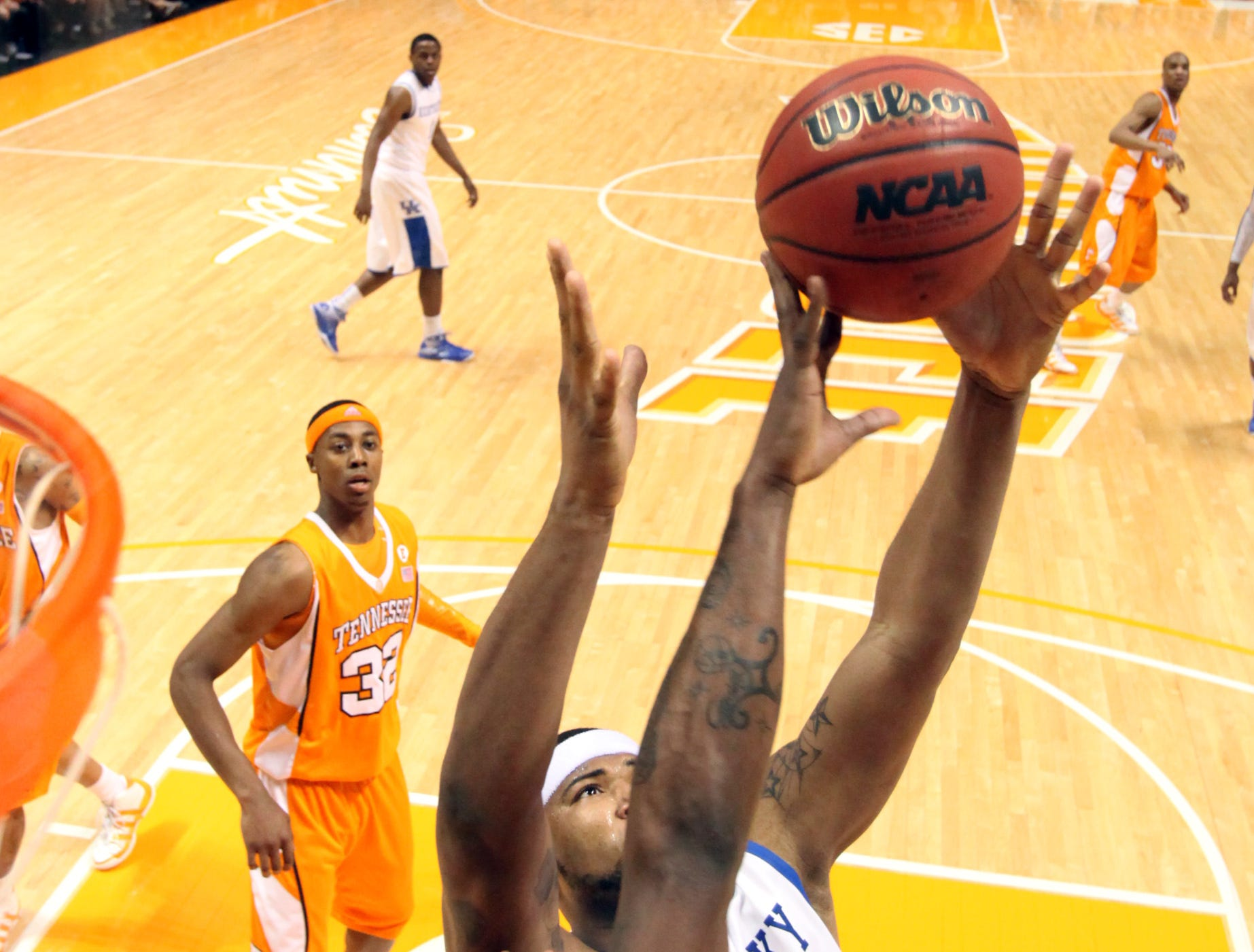 Tennessee forward Wayne Chism tries to stop Kentucky forward DeMarcus Cousins as he goes up for a rebound at Thompson-Boling Arena Saturday, Feb. 27, 2010.  Chism had 6 rebounds and 8 points for the Vols during their 74-65 upset over the Wildcats.