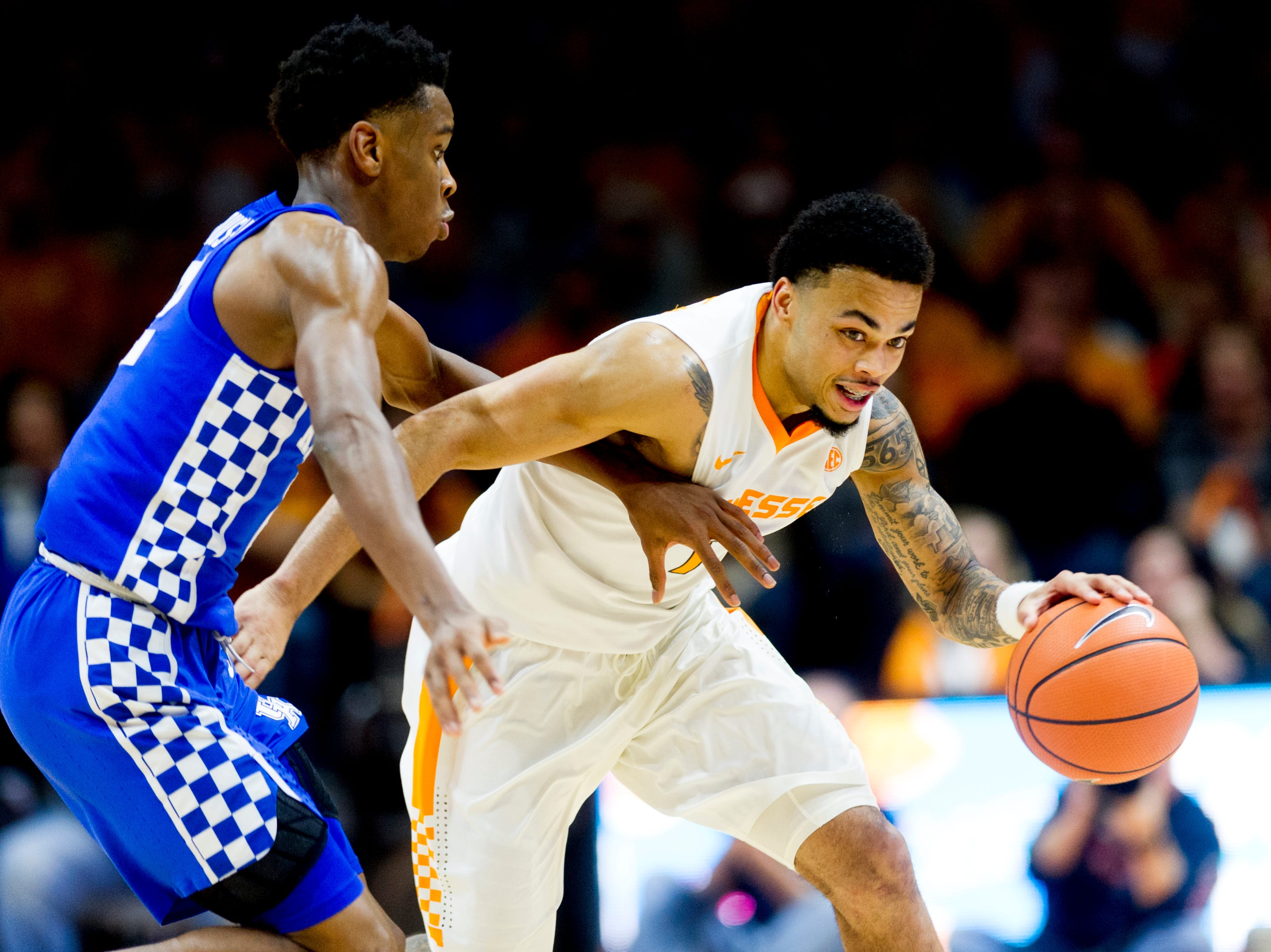 Tennessee guard Lamonte Turner (1) drives the ball past Kentucky guard Shai Gilgeous-Alexander (22) during a game between Tennessee and Kentucky at Thompson-Boling Arena in Knoxville, Tennessee on Saturday, January 6, 2018.