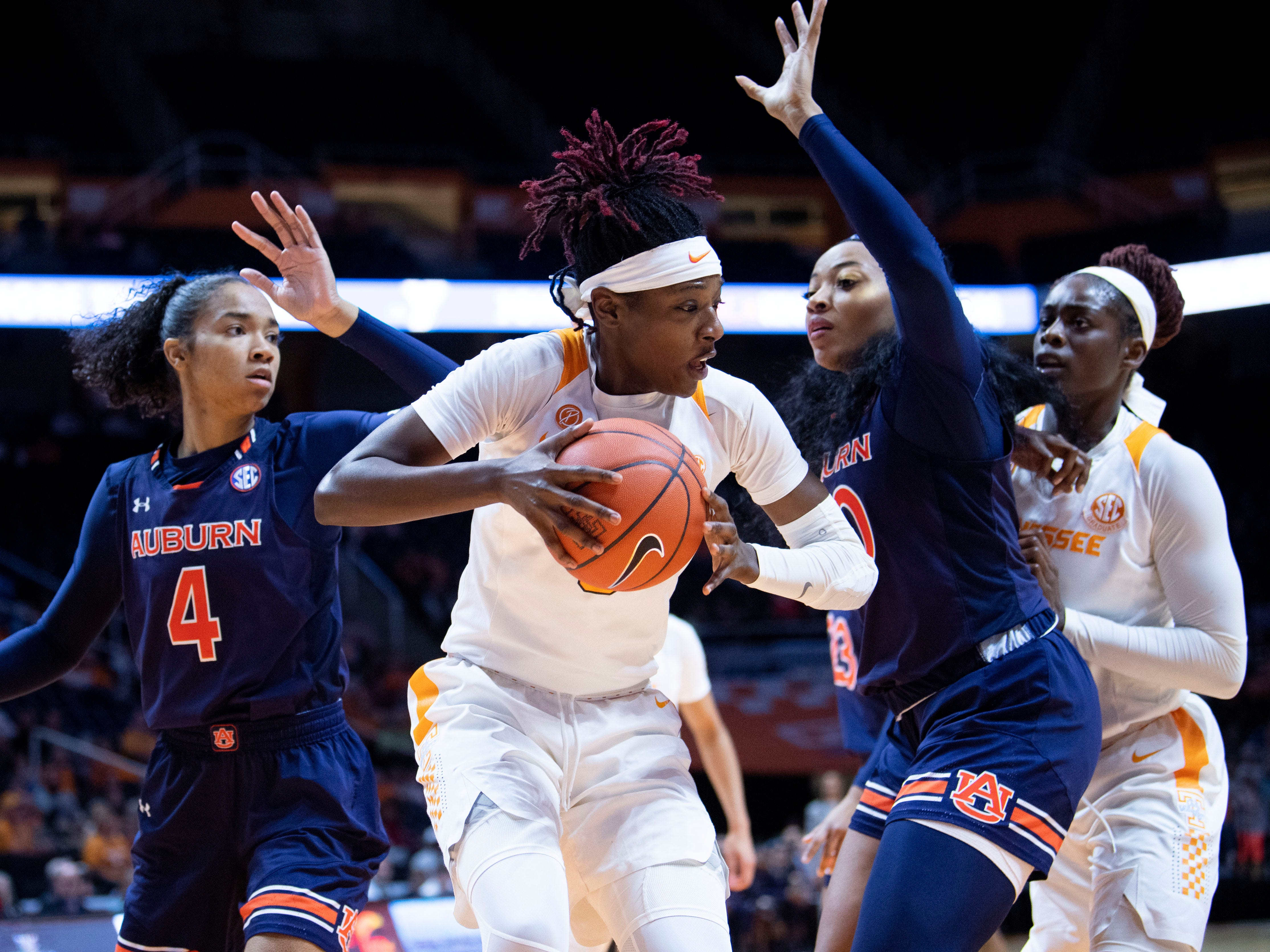 Tennessee's Rennia Davis (0) is guarded by Auburn's Unique Thompson (20) and Abigayle Jackson (4) on Thursday, February 14, 2019.