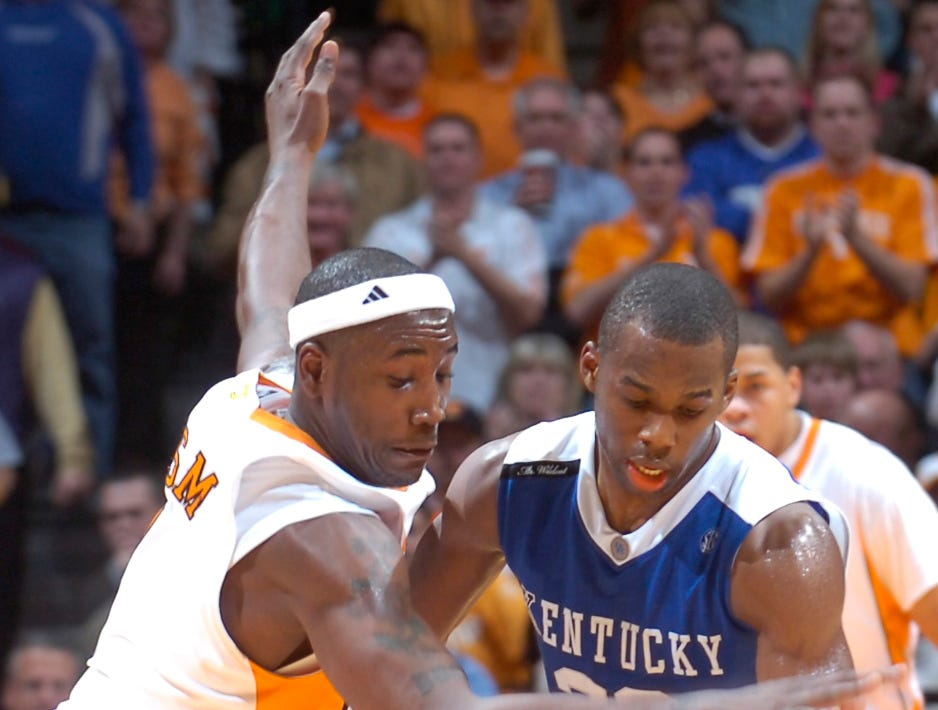 Tennessee's Wayne Chism tries to steal the ball from Kentucky's Jodie Meeks during a game at Thompson Boling Arena in January 2009. Kentucky defeated Tennessee 90-72 with Jodie Meeks scoring 54 points.