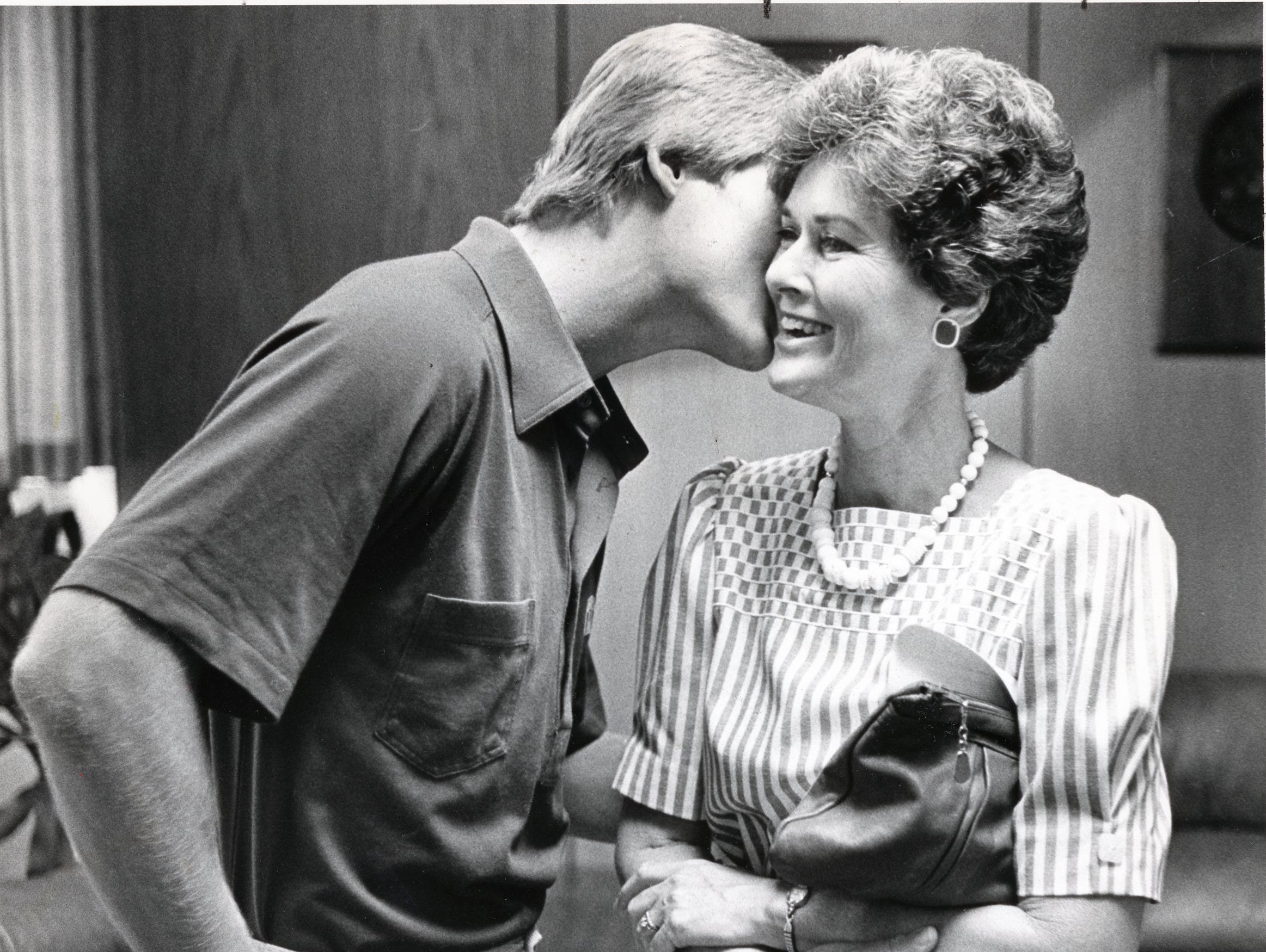 Daryl Dickey kisses his mom, JoAnne, after his father was officially named the new athletic director at the University of Tennessee, August, 1985.