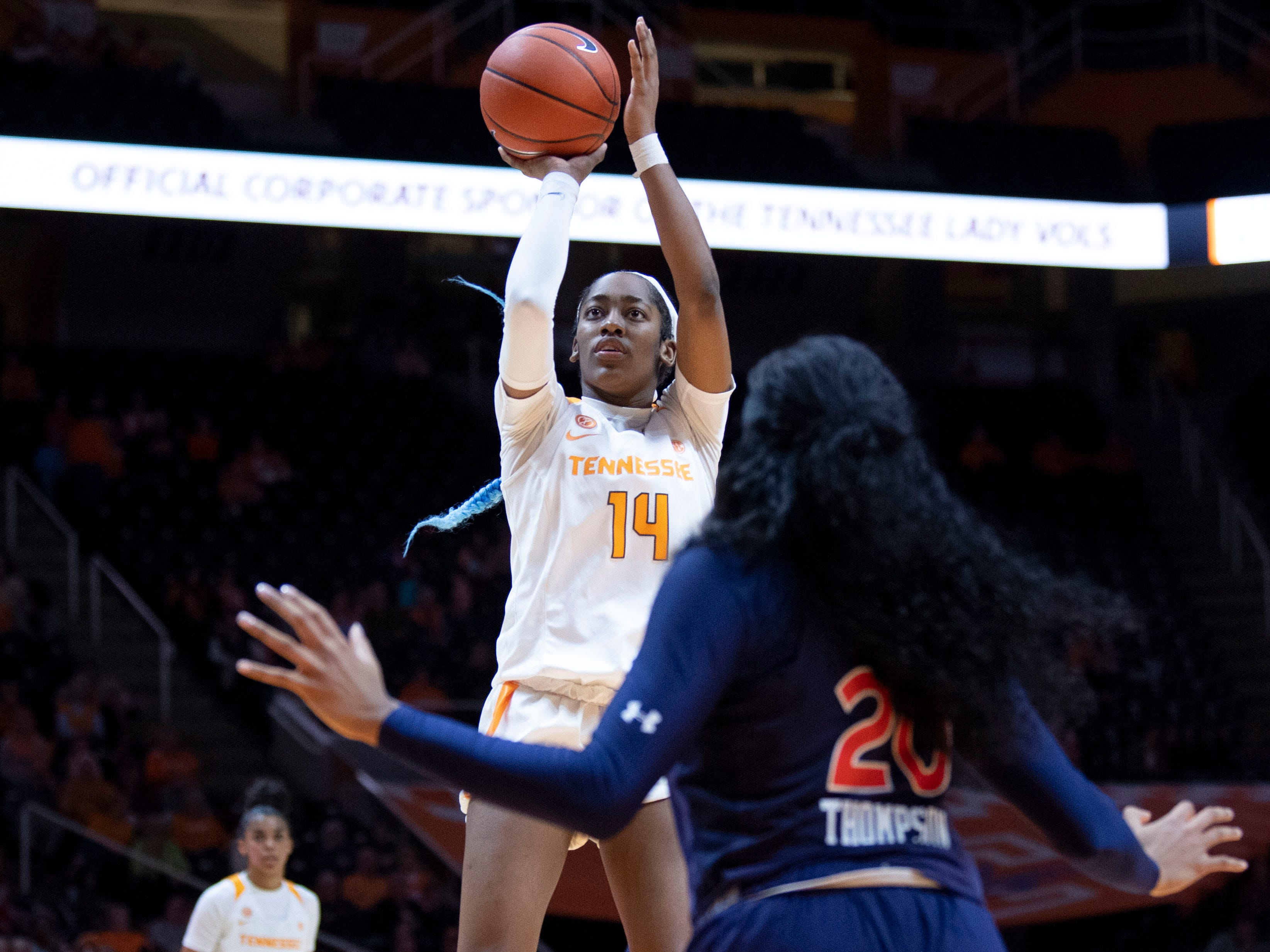 Tennessee's Zaay Green (14) with a jump shot over Auburn's Unique Thompson (20) on Thursday, February 14, 2019.