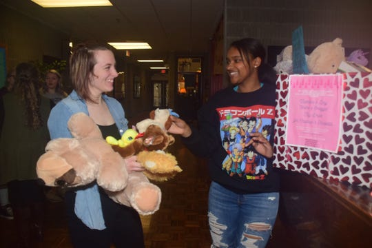 Rebecca Faulkenberry and Delaysha Jones count toys collected during a toy drive to benefit sick kids at East Tennessee Children's Hospital at Byington Solway Tuesday, Feb. 12.