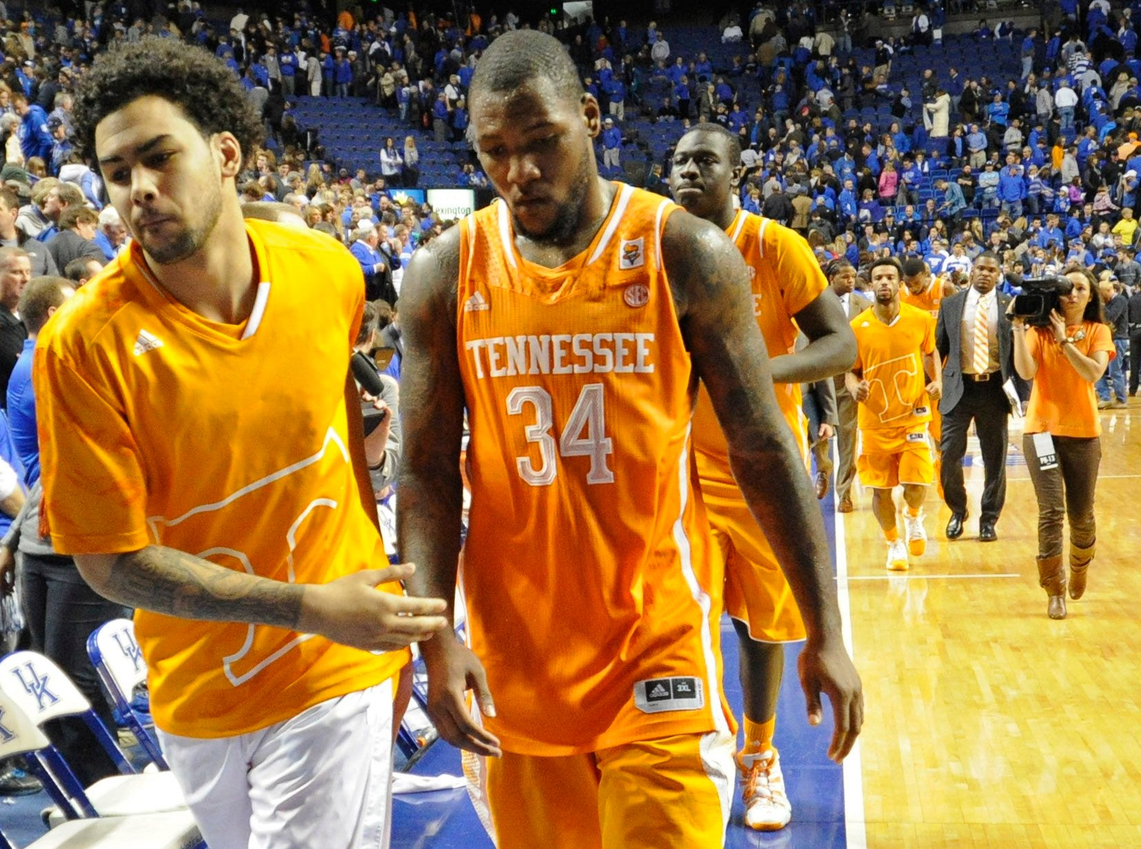 "Tennessee guard Quinton Chievous (31), Tennessee forward Jeronne Maymon (34) and Tennessee center Rawane ""Pops"" Ndiaye (10), from left, walk off court after losing to Tennessee 74-66 at University of Kentucky's Rupp Arena in Lexington on Saturday, Jan. 18, 2014."