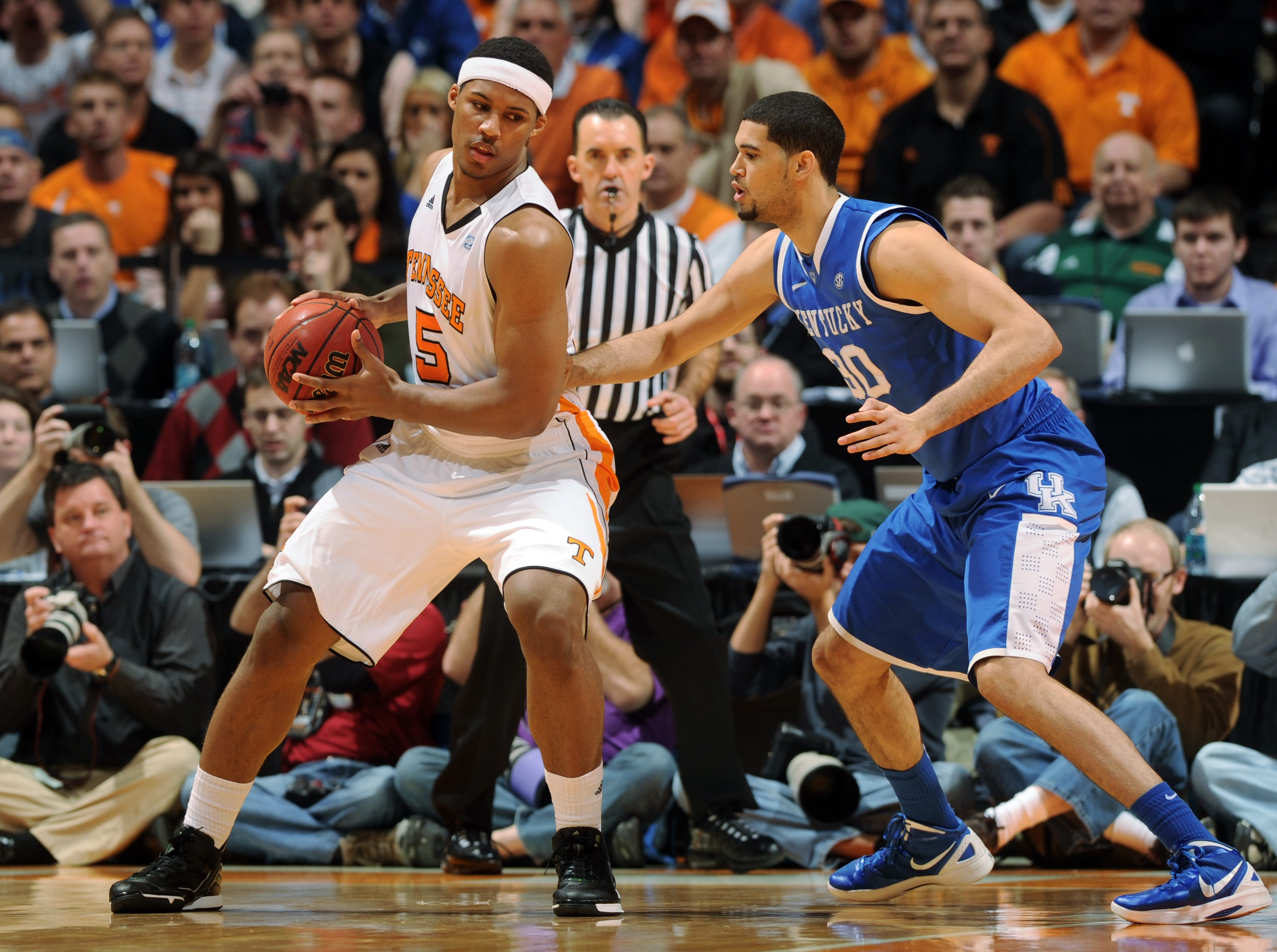 Tennessee forward Jarnell Stokes (5) moves the ball as Kentucky forward Eloy Vargas (30) defends at Thompson-Boling Arena in Saturday, Jan. 14, 2012.  Kentucky defeated Tennessee 65-62.