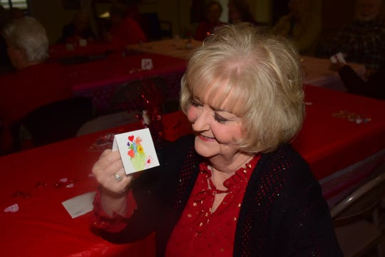 Local artist Judy Didier decorated the tables with hand painted place cards at a Valentine's potluck held at Beaver Ridge United Methodist Church Tuesday, Feb. 12.