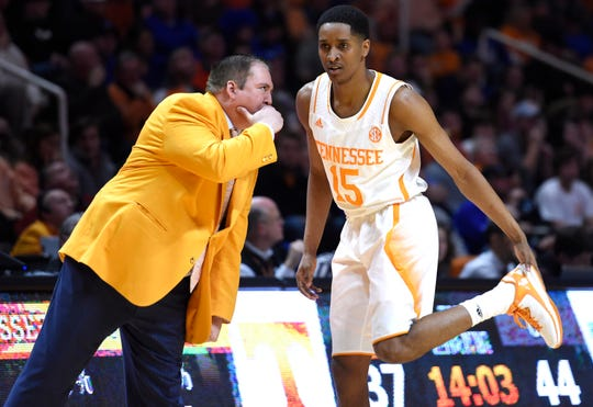 Tennessee head coach Donnie Tyndall confers with Tennessee guard Detrick Mostella (15) on the sideline during the second half against Kentucky at Thompson-Boling Arena in Knoxville on Tuesday, Feb. 17, 2015. Tennessee lost 66-48.
