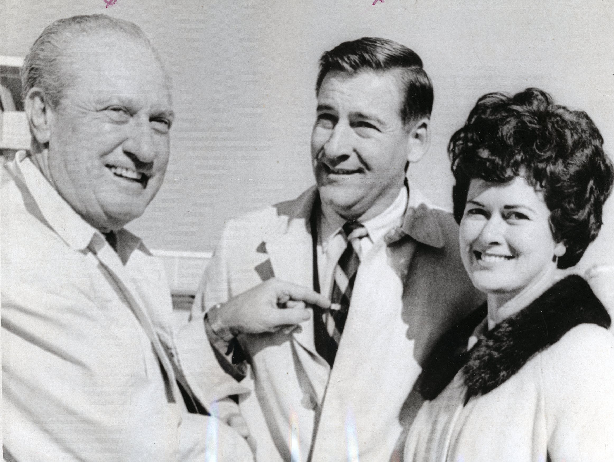 Dallas city councilman Jack McKinney presents Doug and JoAnne Dickey a key to the city of Dallas upon their arrival at Dallas Love Field for the Cotton Bowl. December, 1968