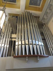 Choir and Great divisions of organ pipes in rear balcony of Sacred Heart Cathedral.