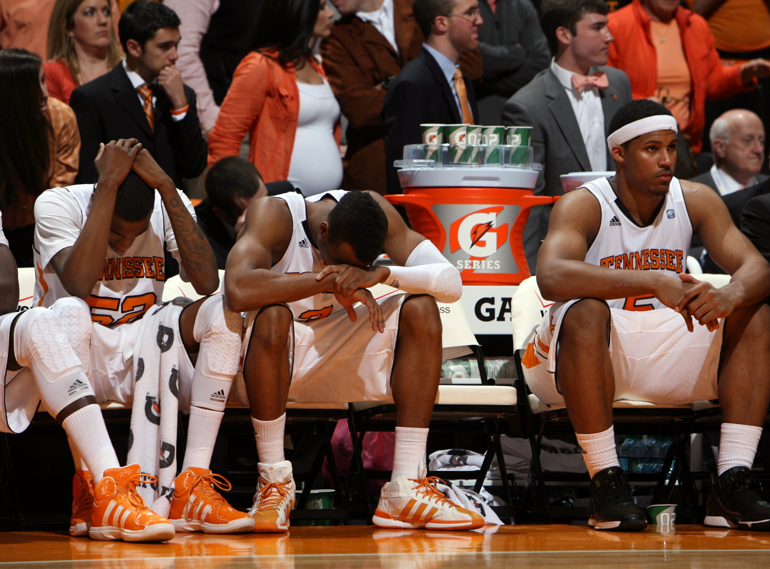 Tennessee forwards Jordan McRae (52), Renaldo Woolridge (3) and Jarnell Stokes (5), left to right, look on as Kentucky Wildcats close out their 65-62 win over the Vols at Thompson-Boling Arena in Saturday, Jan. 14, 2012.