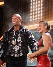 "Dwayne Johnson and Emily Andzulis smile together during ""The Titan Games."""