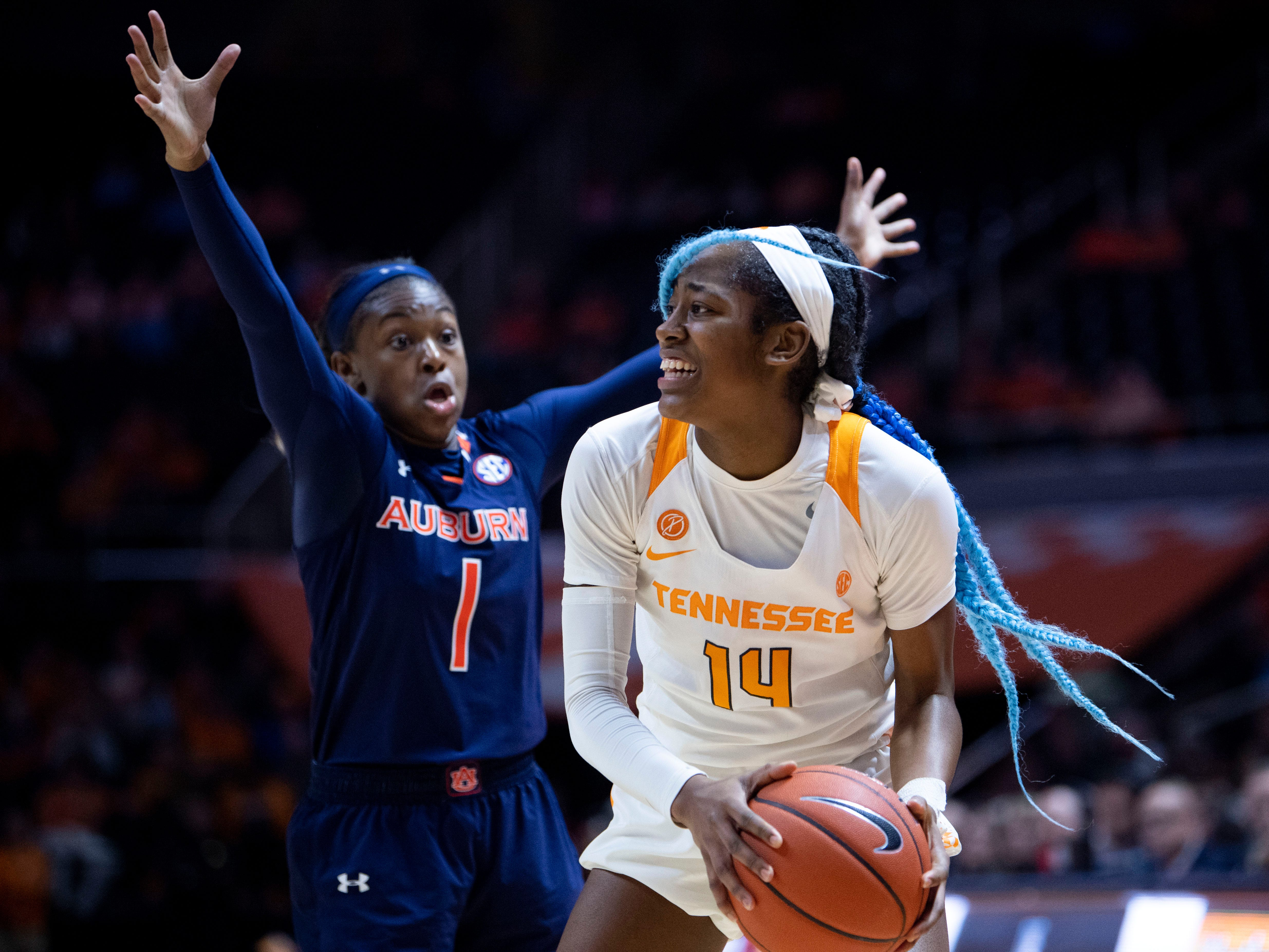 Tennessee's Zaay Green (14) is guarded by Auburn's Robyn Benton (1) on Thursday, February 14, 2019.
