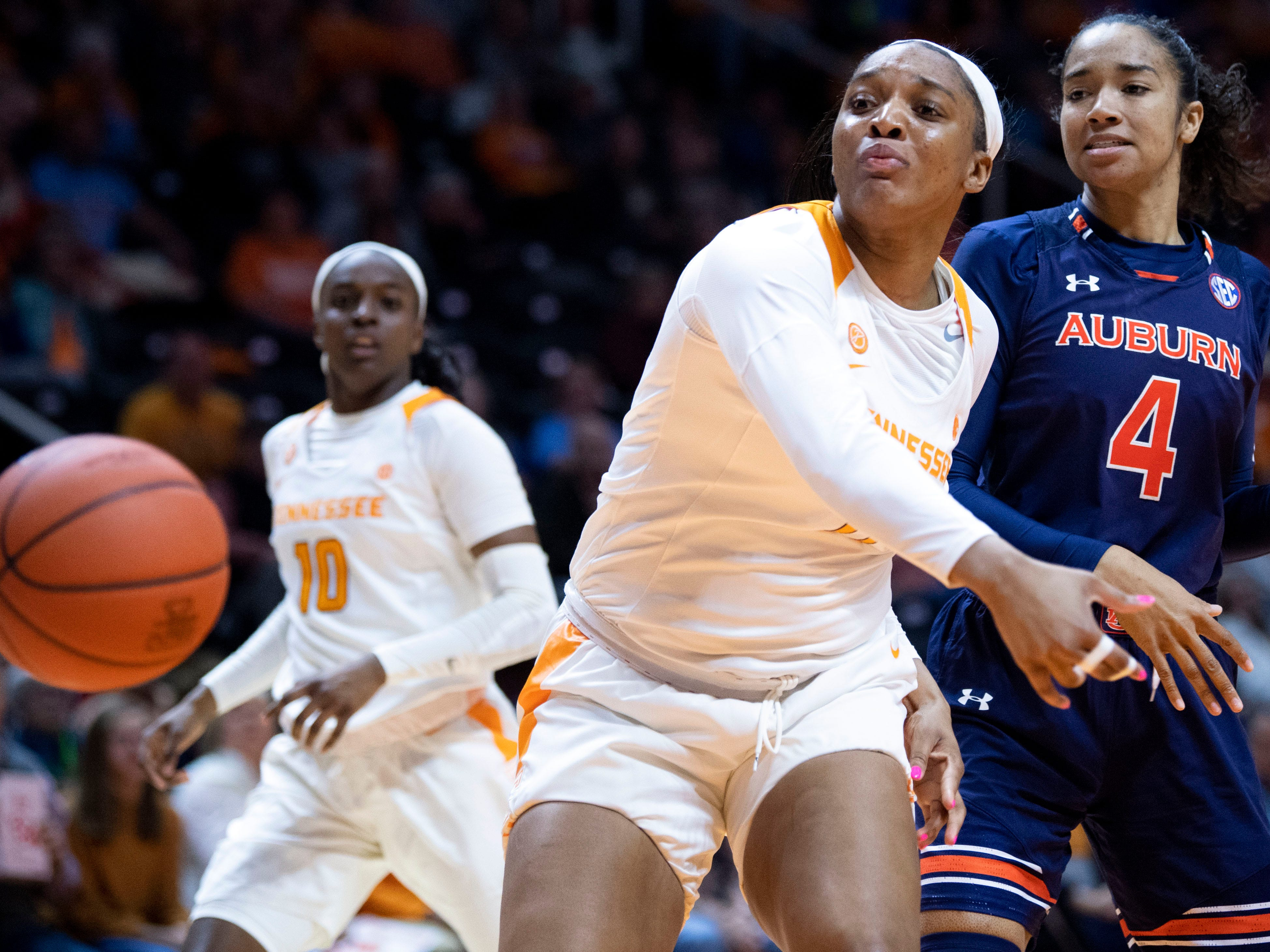 The ball flies out of bounds before Tennessee's Kasiyahna Kushkituah (11) and Auburn's Abigayle Jackson (4) on Thursday, February 14, 2019.