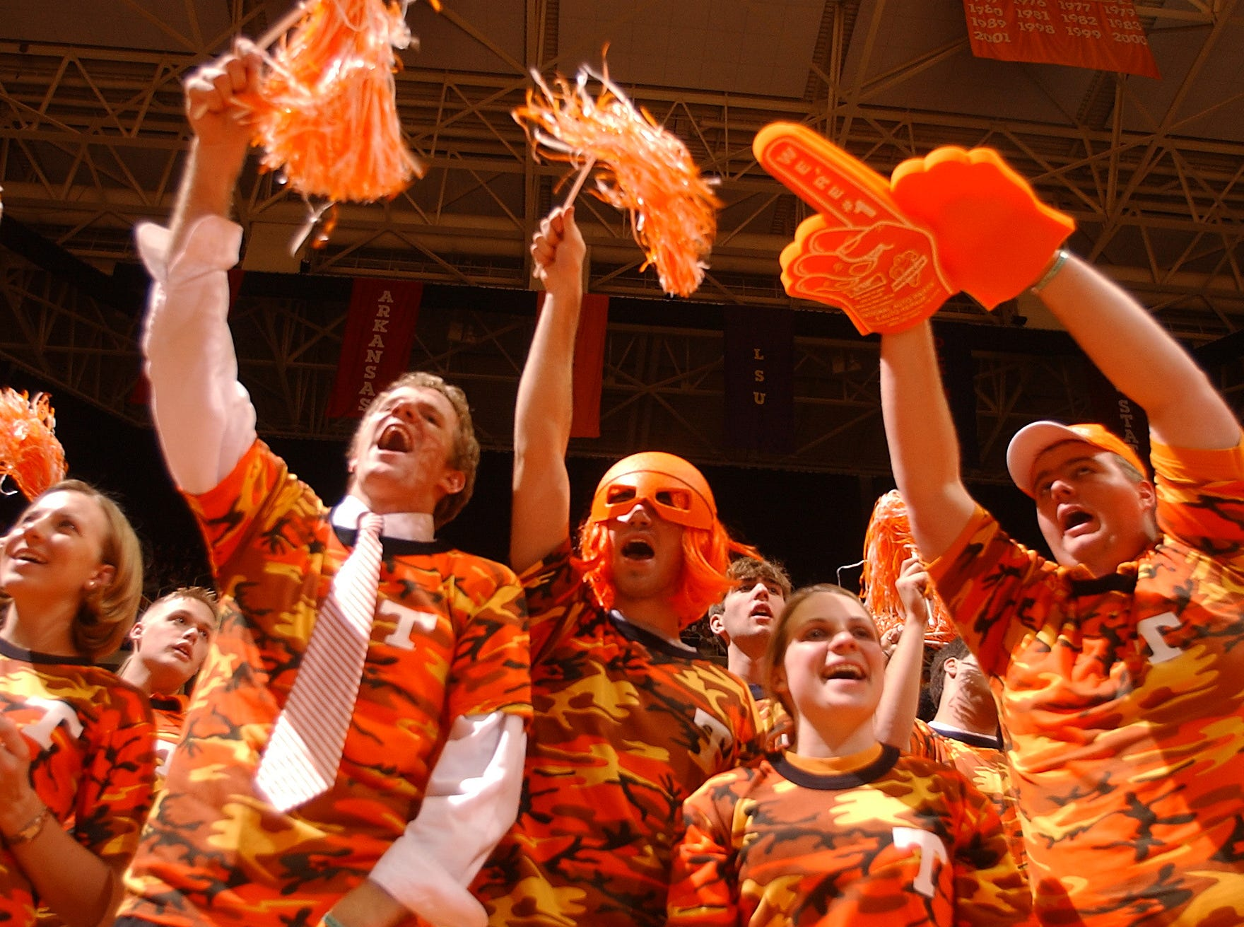 Tennessee fans cheer on the Vols during a one-point loss to Kentucky on Tuesday  atThompson-Boling Arena.  Second from left, Scott Campbell, John Ford and Alee Lynch.
