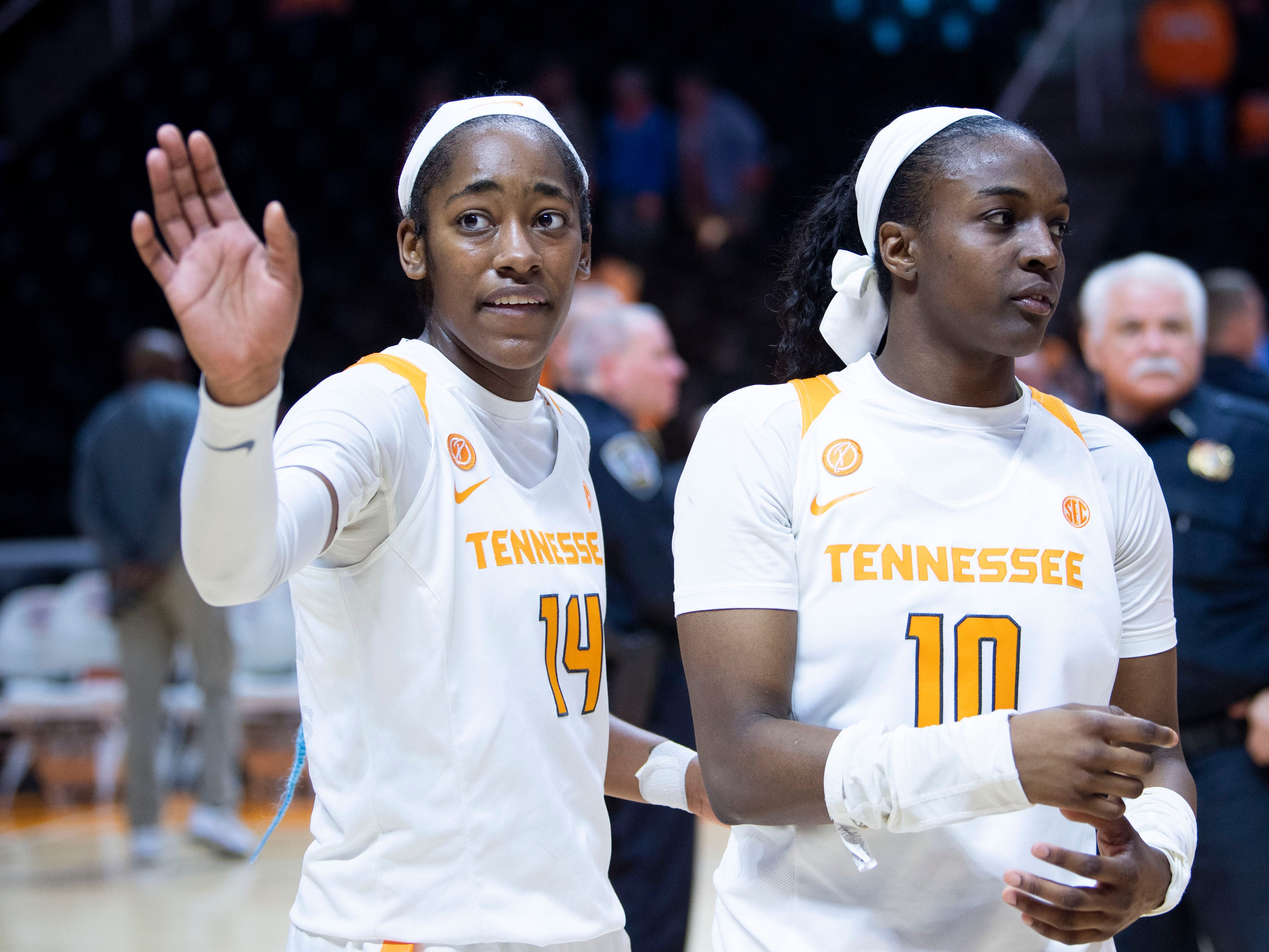 Tennessee's Zaay Green (14) waves to the fans as she and Meme Jackson (10) return to their locker room after 73-62 over Auburn on Thursday, February 14, 2019.