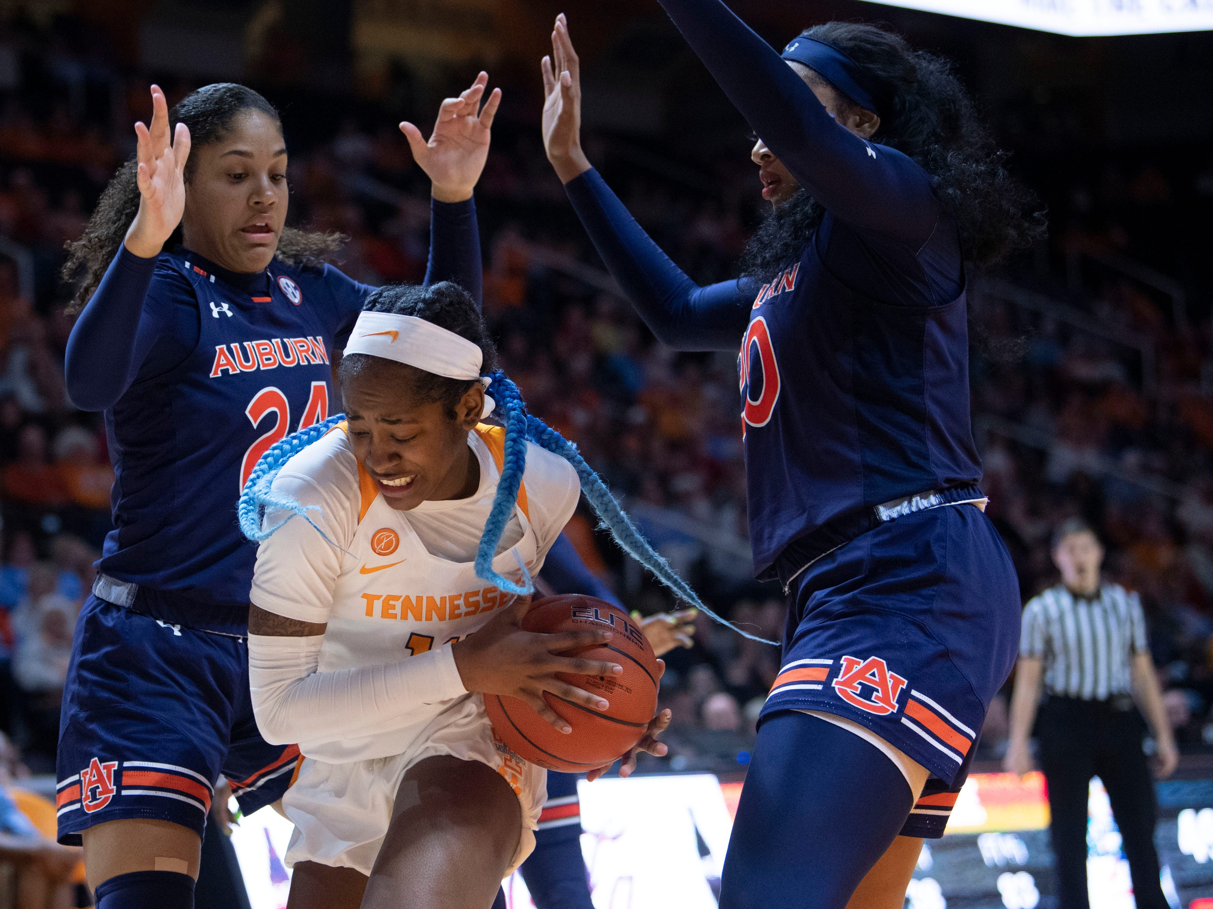 Tennessee's Zaay Green (14) protects the ball from Auburn's Erin Howard (24) and Unique Thompson (20) on Thursday, February 14, 2019.