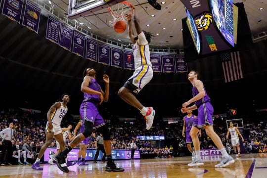 Dec 21, 2018; Baton Rouge, LA, USA; LSU Tigers forward Naz Reid (0) dunks the ball against Furman Paladins forward Noah Gurley (4) in the second half at Maravich Assembly Center. Mandatory Credit: Stephen Lew-USA TODAY Sports