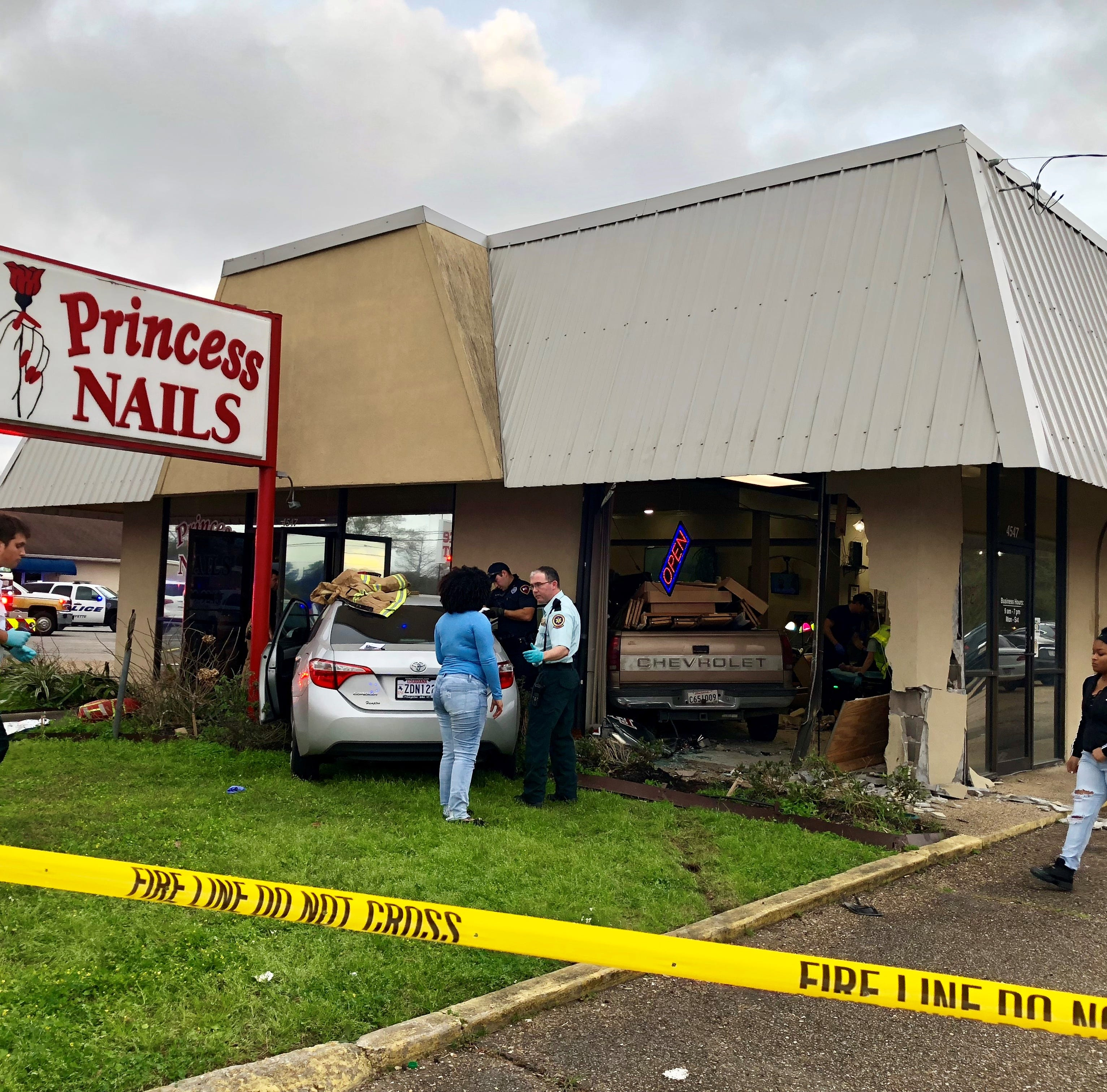 Lafayette Police and other first responders are on the scene of an accident in which a truck crashed through the wall of Princess Nails on Johnston Street, injuring several people.