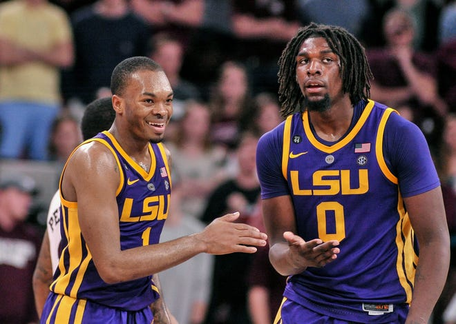 Feb 6, 2019; Starkville, MS, USA; LSU Tigers guard Ja'vonte Smart (1) and  forward Naz Reid (0) react during the second half against the Mississippi State Bulldogs at Humphrey Coliseum. LSU defeated Mississippi State 92-88 in overtime. Mandatory Credit: Justin Ford-USA TODAY Sports
