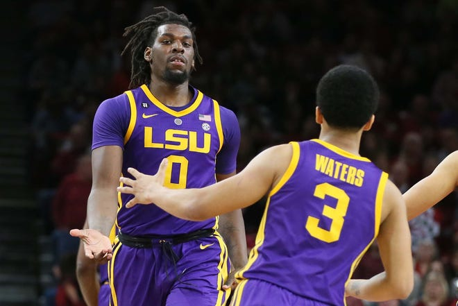 Jan 12, 2019; Fayetteville, AR, USA; LSU Tigers forward Naz Reid (0) celebrates with guard Tremont Waters (3) after a score by Reid against the Arkansas Razorbacks at Bud Walton Arena. LSU won in overtime 94-88. Mandatory Credit: Nelson Chenault-USA TODAY Sports