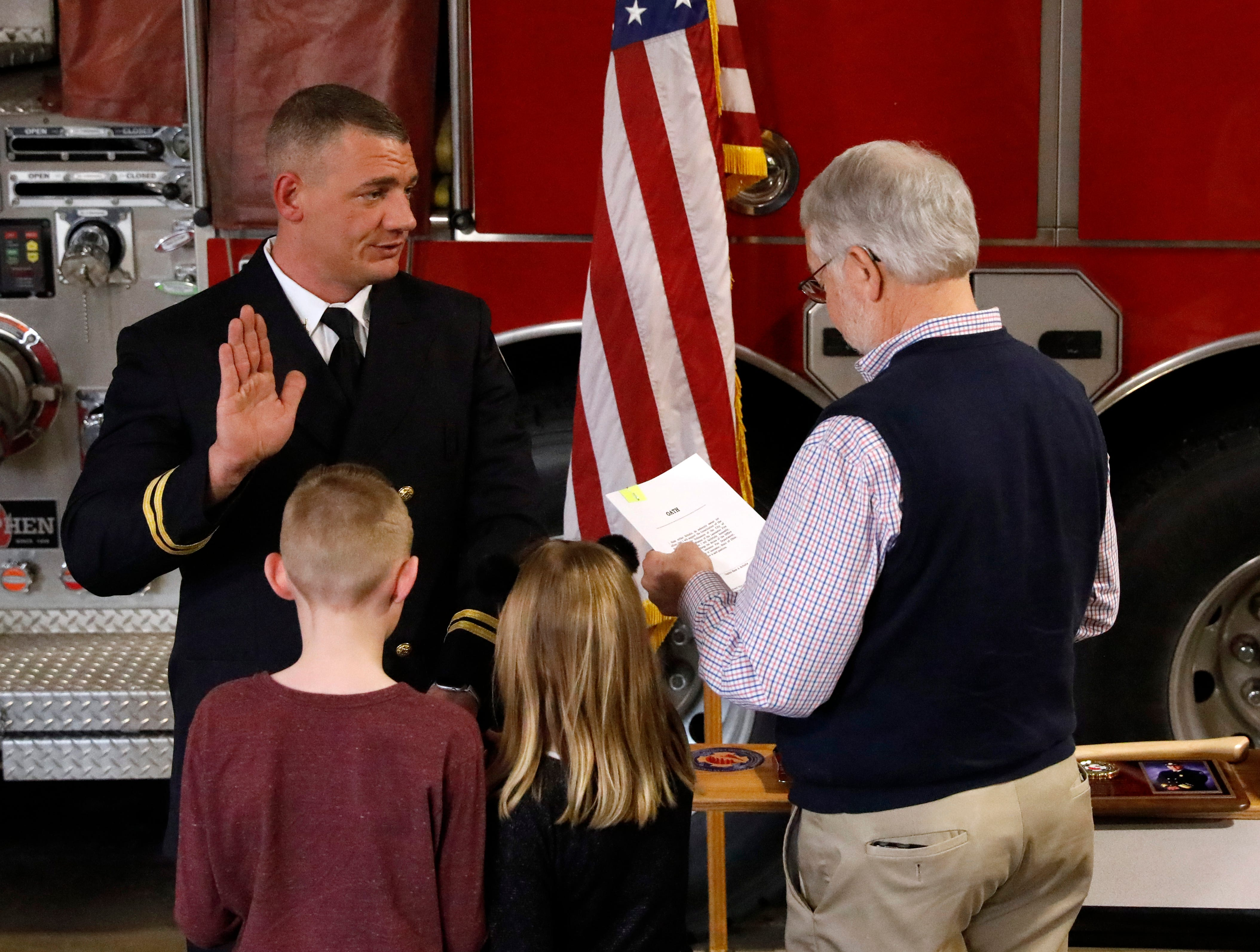 Capt. Slade Schultz is sworn into his new position with the Lancaster Fire Department by Mayor David Scheffler Friday afternoon, Feb. 15, 2019, at Engine House One in Lancaster.