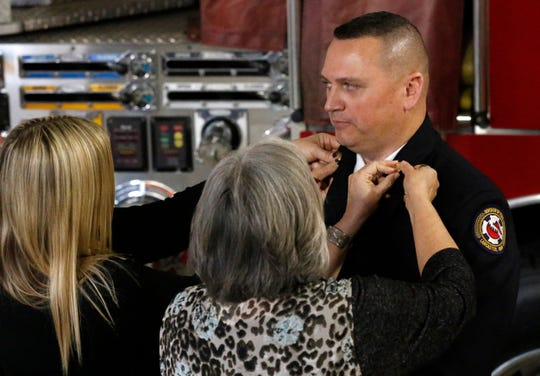 Lancaster Fire Department Assistant Chief K.J. Watts, shown during his at his swearing-in ceremony for his current position last year, recently recovered from the coronavirus. He was sick for about two weeks and said the illness feels 10 times worse than the flu.
