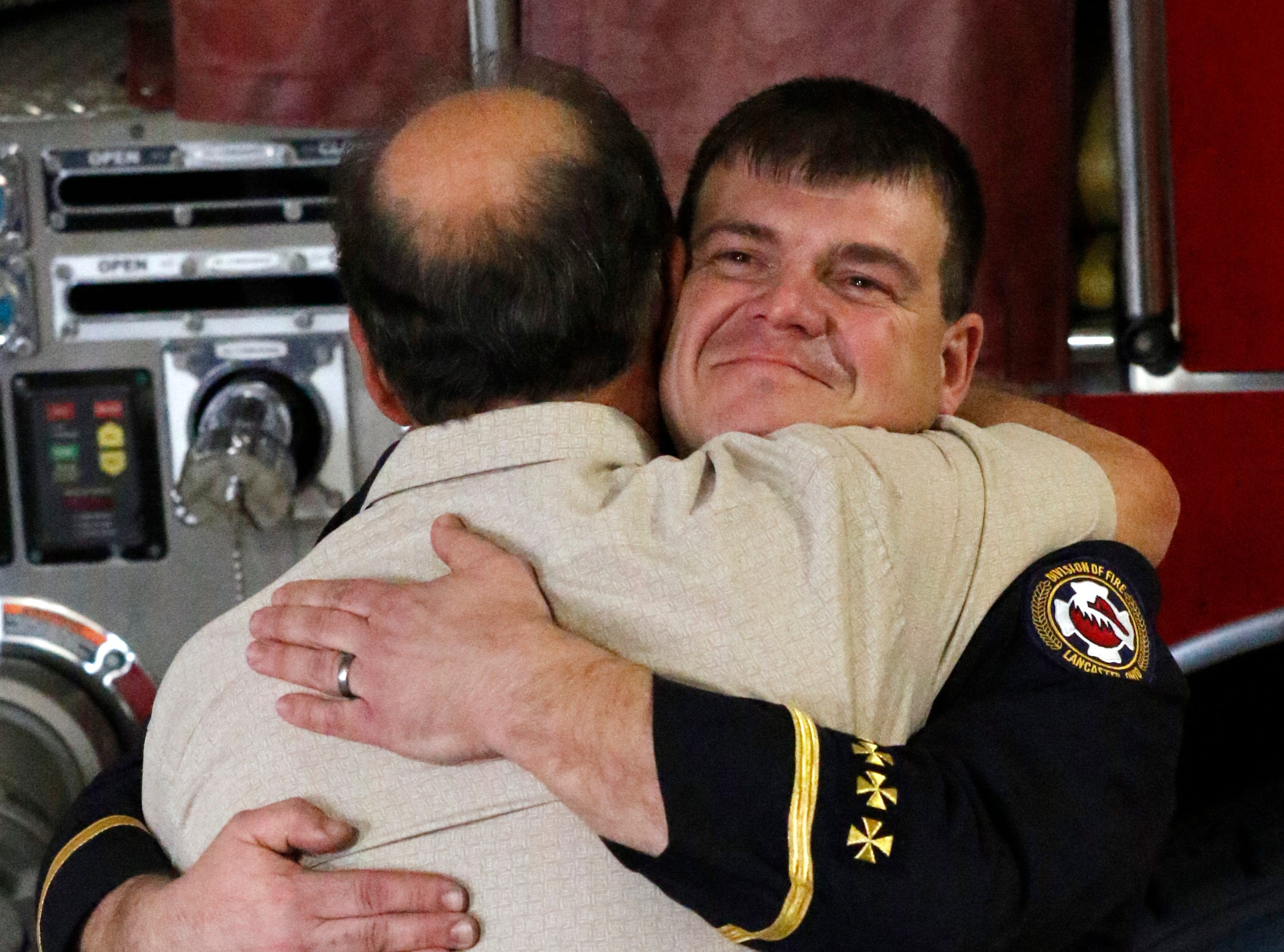 Lancaster Fire Department Lt. Jeremy Kraner hugs his father retired LFD Assistant Chief John Kraner during his promotion ceremony Friday afternoon, Feb. 15, 2019, at Engine House One in Lancaster.