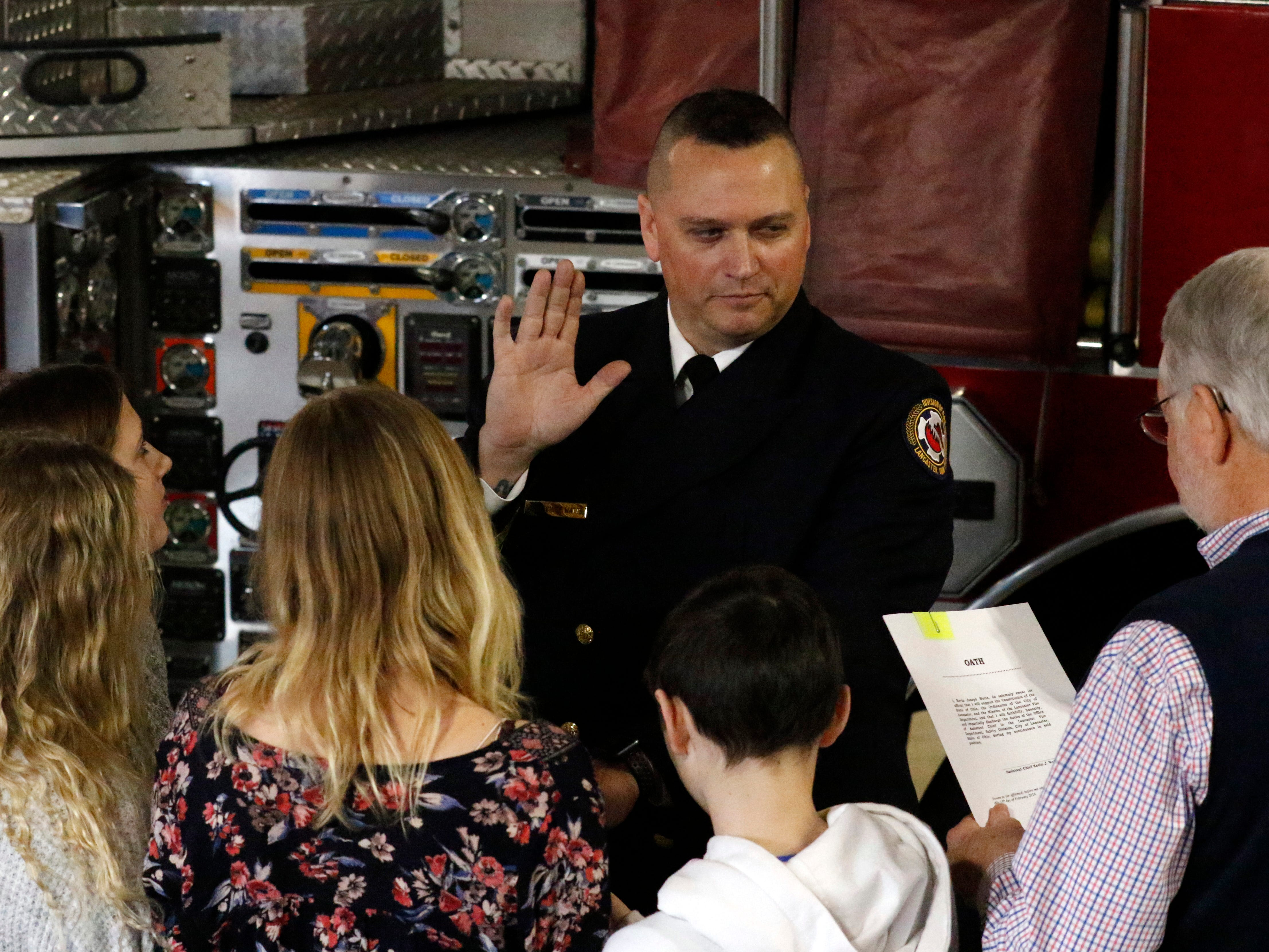 Assistant Chief K.J. Watts is sworn into his new position with the Lancaster Fire Department by Mayor David Scheffler Friday afternoon, Feb. 15, 2019, at Engine House One in Lancaster.