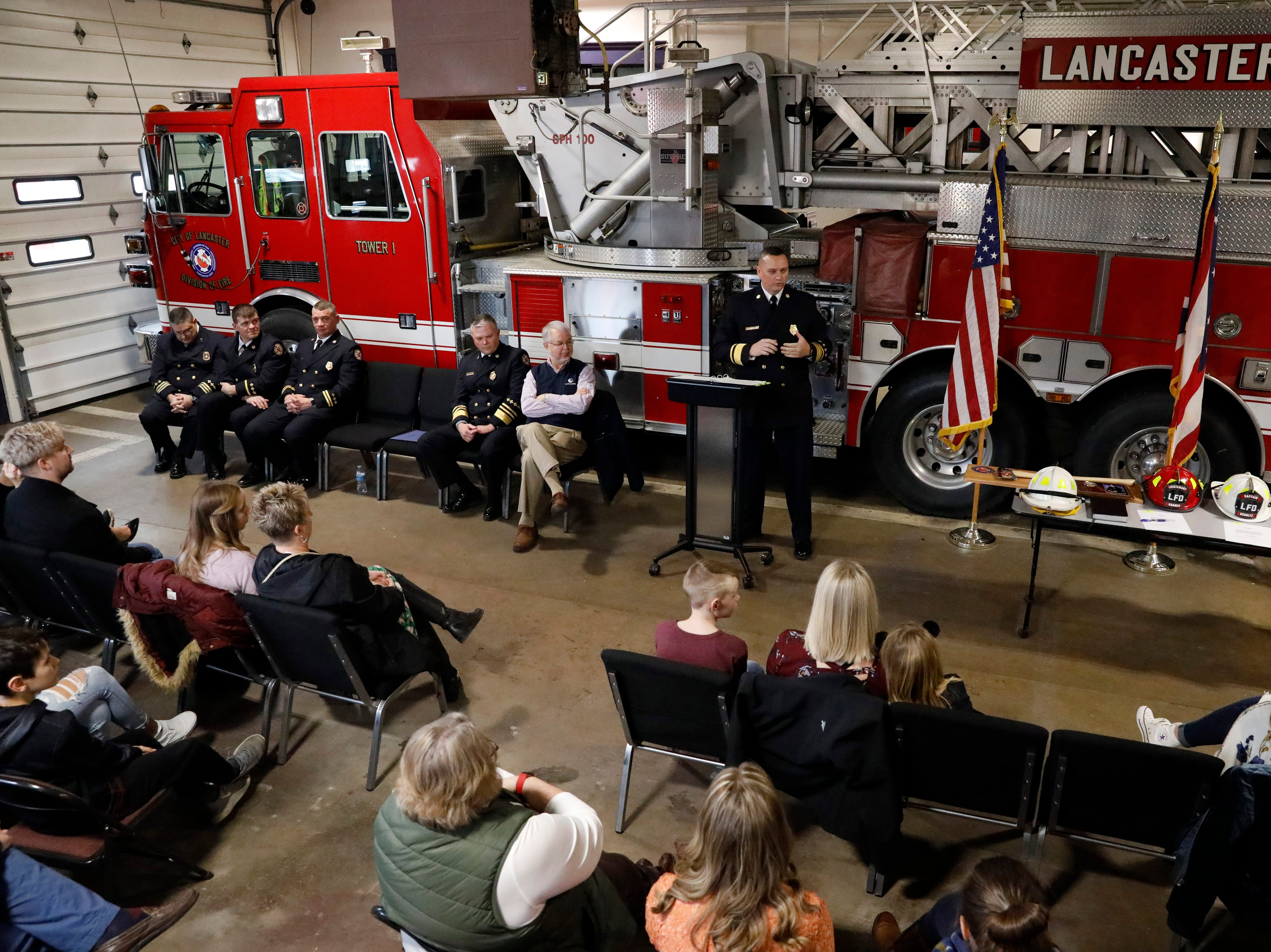 Newly sworn in Assistant Fire Chief K.J. Watts speaks to a crowd gathered in the truck bay of Engine House One Friday afternoon, Feb. 15, 2019, in Lancaster. Watts. Capt. Slade Schultz and Lt. Jeremy Kraner were sworn into their new ranks following the retirement of Assistant Chief Jack Mattlin.
