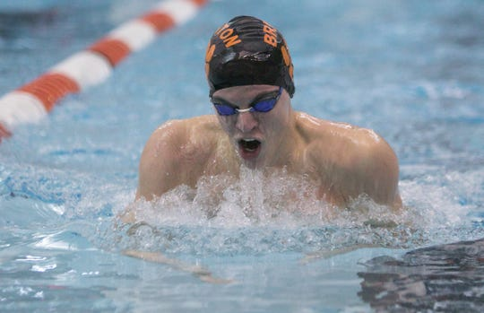 Brighton's Drew Panzl swims to victory in the 100-yard breaststroke in 1:04.09 against Howell on Thursday, Feb. 14, 2019.