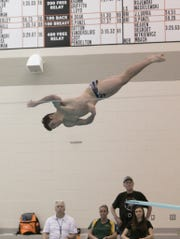Brighton's Cade Hammond won diving with a score of 309.50 points against Howell on Thursday, Feb. 14, 2019.