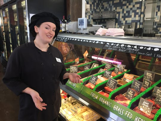Cece Bright, Simply Fresh Market's chef de cuisine, discusses the market's new locally-sourced meat counter, Friday, Feb. 15, 2019.