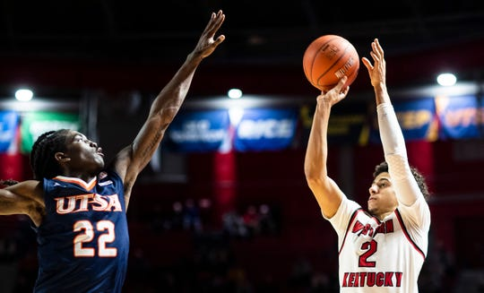 Western Kentucky Hilltoppers guard Jared Savage (2) shoots over Texas-San Antonio Roadrunners guard Keaton Wallace (22) during WKU's 96-88 overtime win over UTSA.