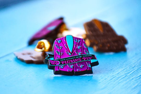 The 2019 Kentucky Derby Festival pin features the Festival's official jacket uniform.