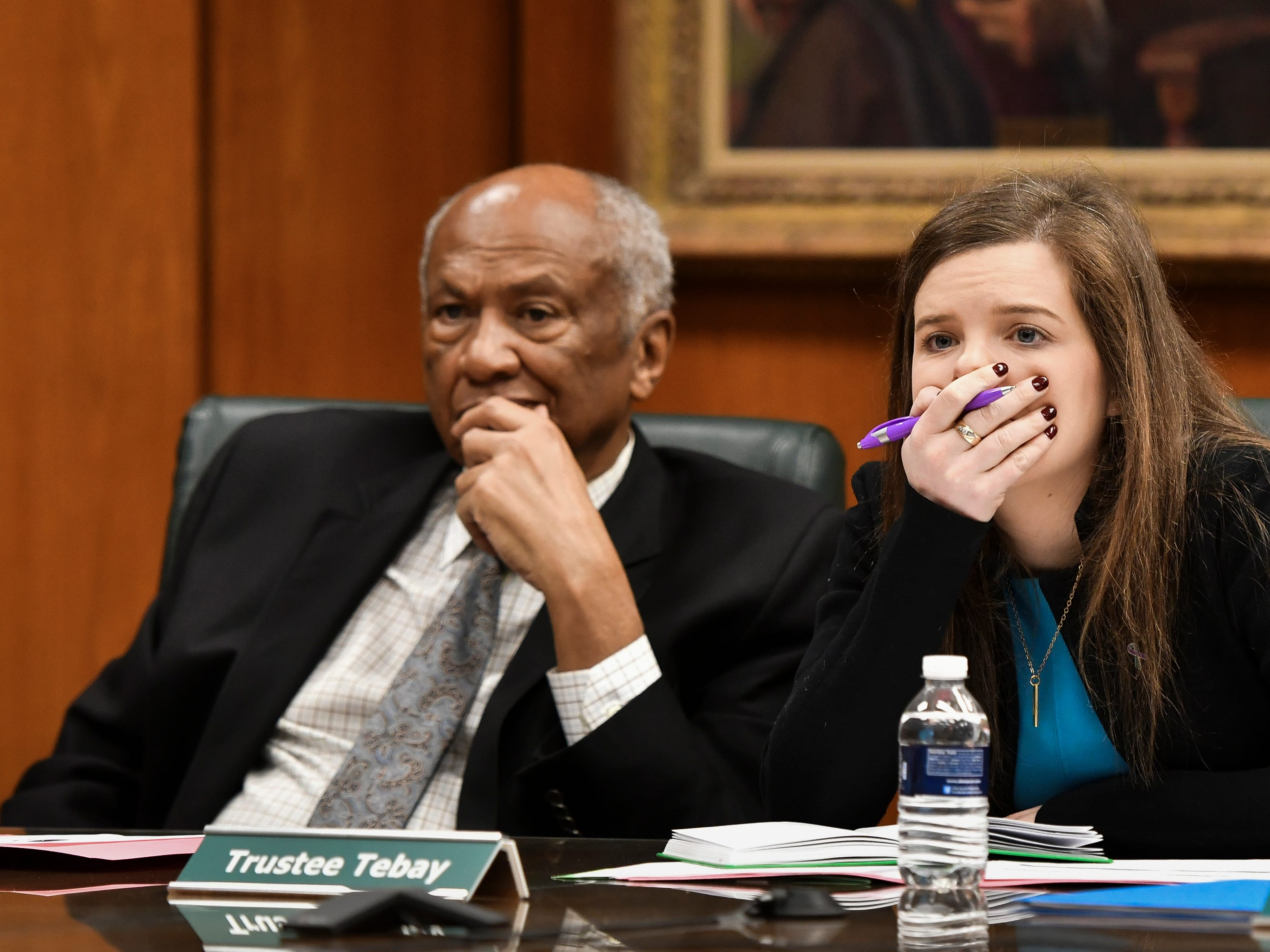 MSU Board of Trustees members Joel Ferguson, left, and Kelly Tebay listen as a victim of former MSU sportmedicine doctor talks about her abuse Friday, Feb. 15, 2019, at the public board meeting.