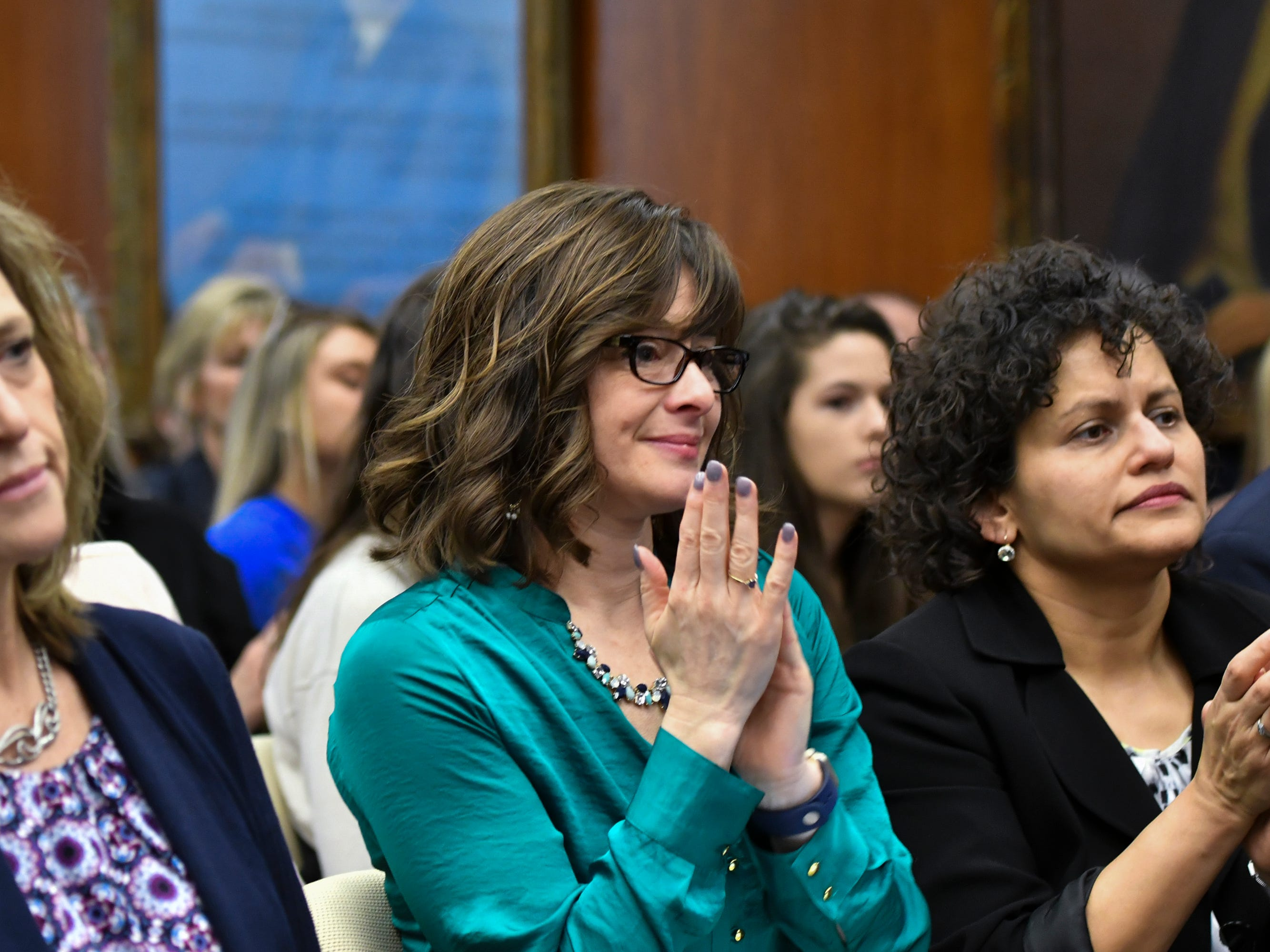 People react after MSU interim President Satish Udpa apologized to victim of Larry Nassar during the Board of Trustees meeting Friday, Feb. 15, 2019, at MSU.