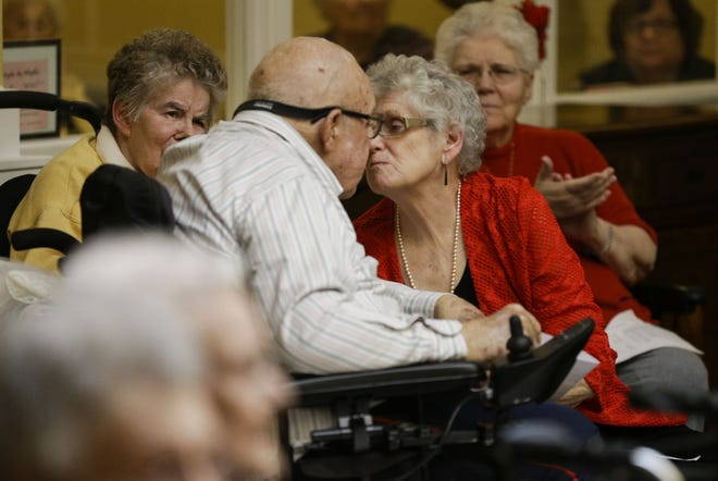 Richard Christensen and his spouse, Sandy Christensen, kiss to commemorate their vow renewal on Thursday, Feb. 14, 2019, at Stoney River Assisted Living in Marshfield, Wisconsin.