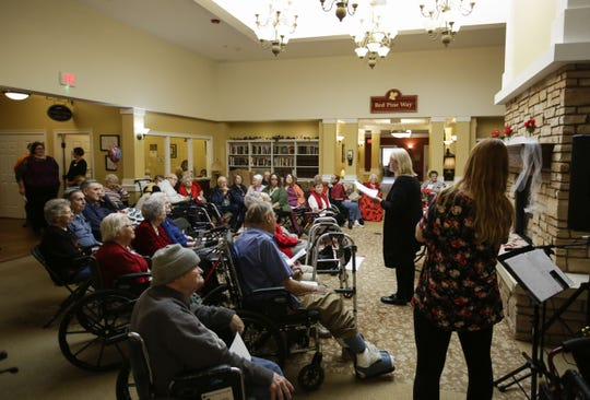 Residents gather for a wedding vow renewal ceremony on Thursday, Feb. 14, 2019, at Stoney River Assisted Living in Marshfield, Wisconsin.