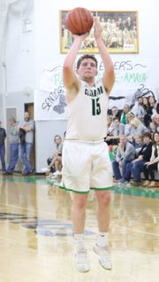 Clear Fork's Jay Swainhart drills a 3-pointer in the Colts MOAC title clinching win over Marion Harding.