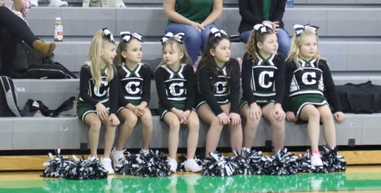 Clear Fork mini cheerleaders wait for their chance to cheer on the Colts.