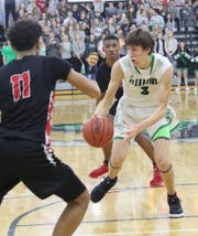Clear Fork's AJ Blubaugh looks for an open lane to the rim during the Colts' Mid-Ohio Athletic Conference championship clinching win over Marion Harding on Thursday.
