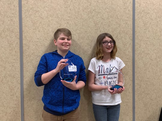 Kairi Robertson, right, and Drake Moyer, left, placed first and second place, respectively, in the 2019 Tri-County Spelling Bee on Thursday, Feb. 14.