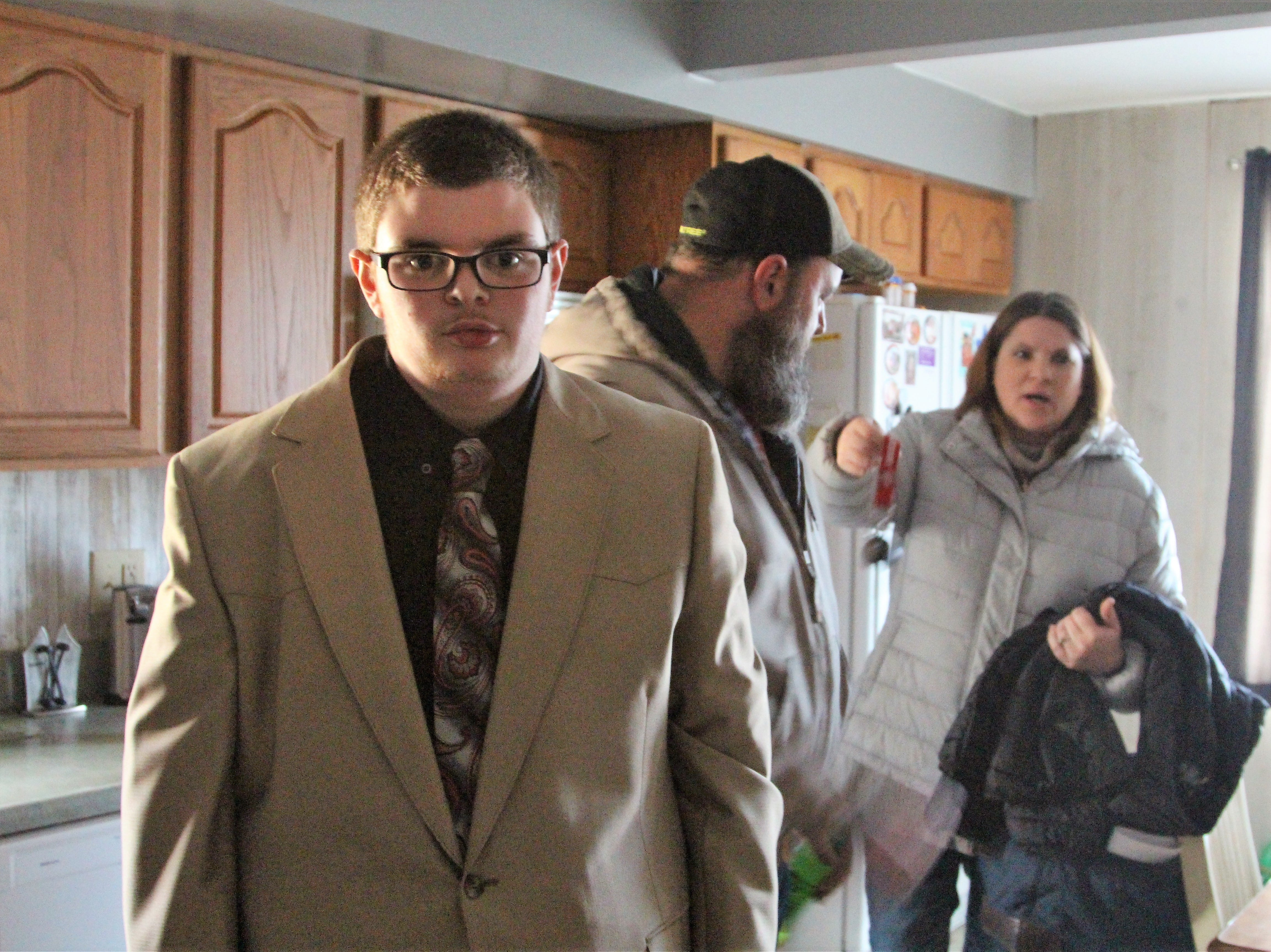 Presden deal wears the suit jacket his Grandfather bought for him as his family prepares to make a trip to downtown Marion. They attended the Night to Shine, a dance for those with special needs.