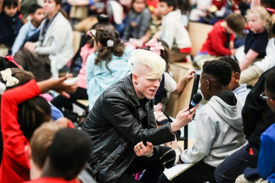 Robdarius Brown, also known as Roben X, takes a question from a student at Grahamwood Elementary School on Feb. 14, 2019. Brown is a rap artist who was bullied in Memphis' schools because he was born with albinism. He spoke with students about bullying.