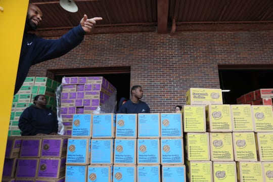 """Girl Scout Cookie """"Count N' Go"""" distribution at Armstrong Relocation where they are unloading nearly 77,000 cases of the famed cookie boxes Friday, Feb. 15, 2019."""