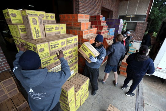 "Girl Scout Cookie ""Count N' Go"" distribution at Armstrong Relocation where they are unloading nearly 77,000 cases of the famed cookie boxes Friday, Feb. 15, 2019."