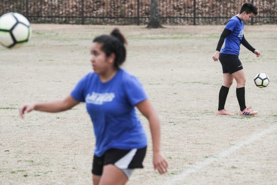 Thaina' Aparecida de Paula, left, and Juliane Guimaraes Alcantara, soccer players at Southwest Tennessee Community College, practice Feb. 5, 2019, at St. George's Independent School in Collierville.