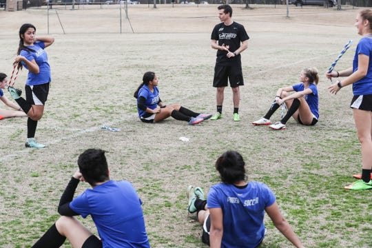 Coach Brandon VanCleave talks with his players at the end of a Southwest Tennessee Community College soccer practice Feb. 5, 2019, at St. George's Independent School in Collierville.