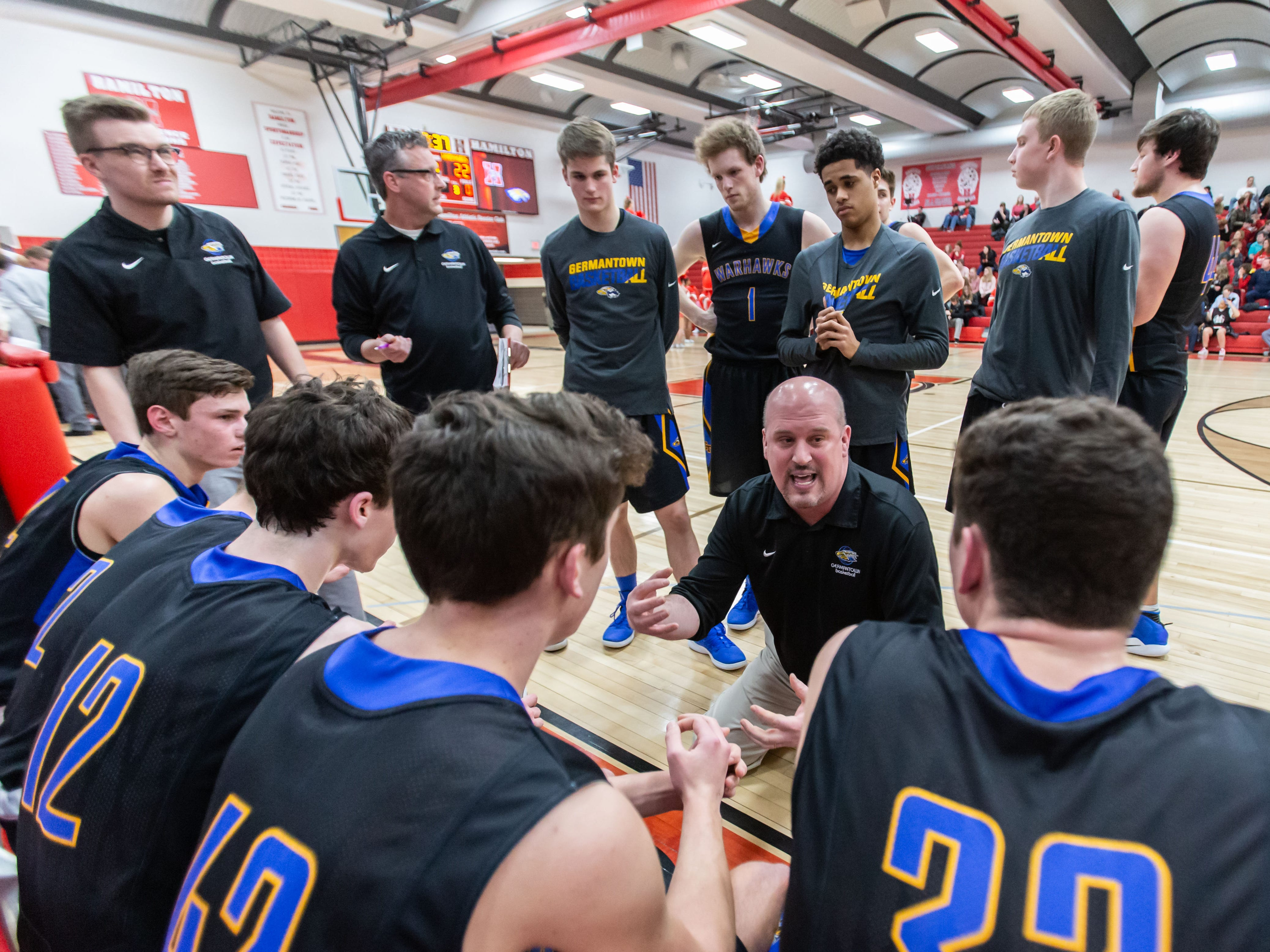 Germantown's head coach Steve Martin talks with his players during the game at Hamilton on Thursday, Feb. 14, 2019.