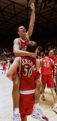 Wisconsin forward Mark Vershaw (50) carries teammate Mike Kelley following Wisconsin's 66-59 upset win over Arizona in the second round of the NCAA West Regional in Salt Lake City on Saturday, March 18, 2000.